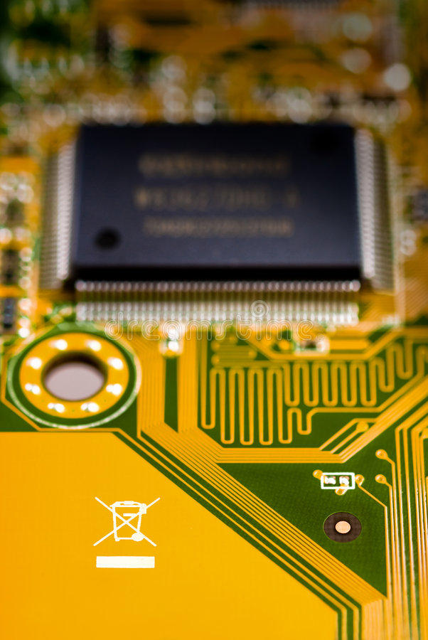 Recycle symbol on circuit board. Circuit board with chip-set and recycle symbol stock images