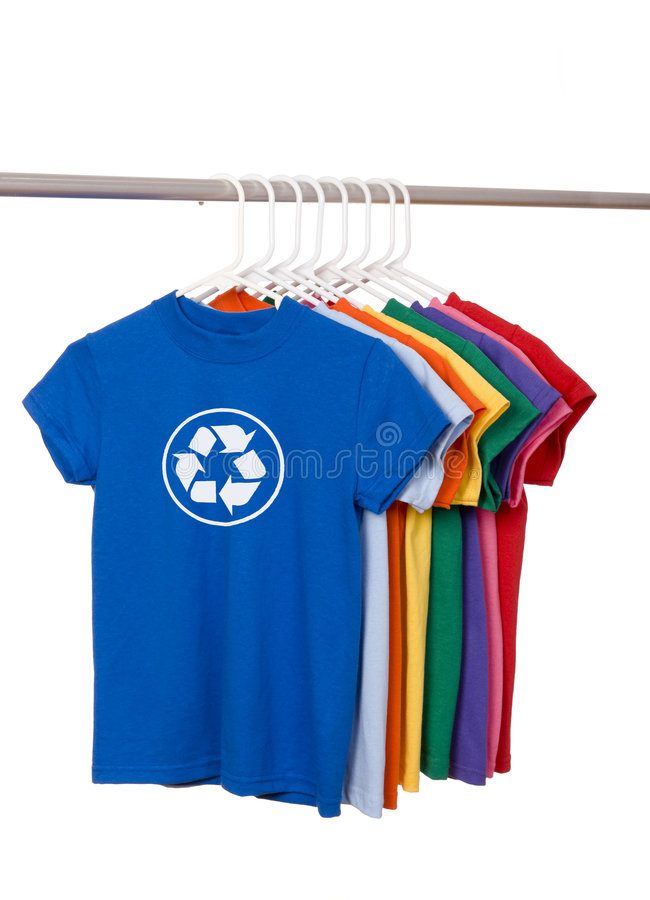Recycle T-Shirts. A group of brightly colored t-shirts on a white background with a recycle symbol on the front royalty free stock photography