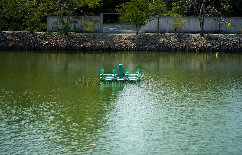 Recycle waste water treatment or renovation machine in pond royalty free stock photography