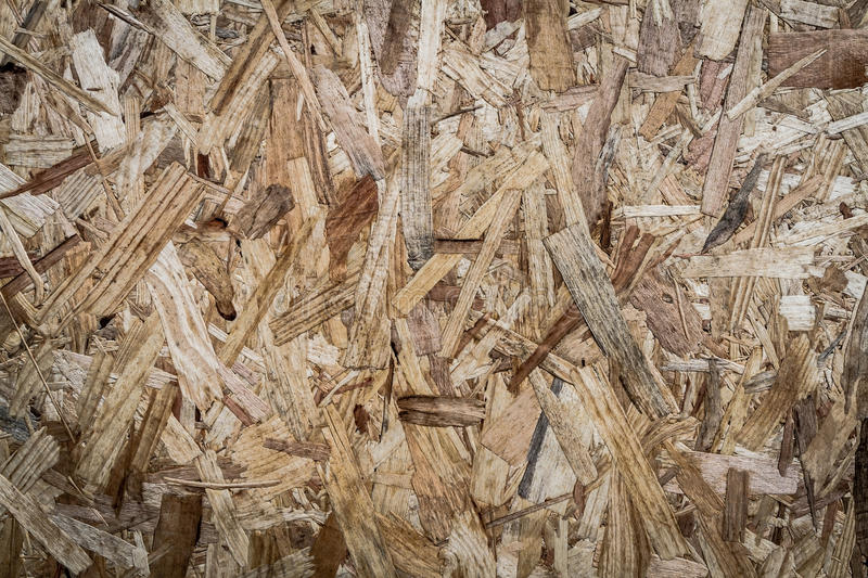 Recycled compressed plywood board texture. Background royalty free stock photos