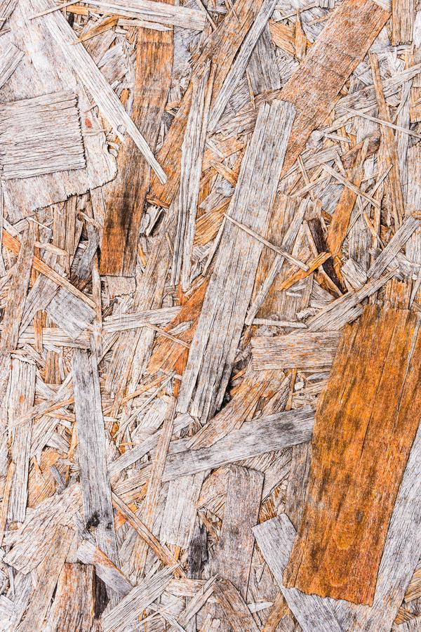 Recycled compressed wood chippings board background. Texture of wooden material stock photography