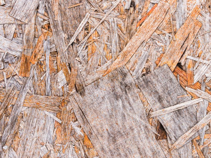 Recycled compressed wood chippings board background. Texture of wooden material royalty free stock photography
