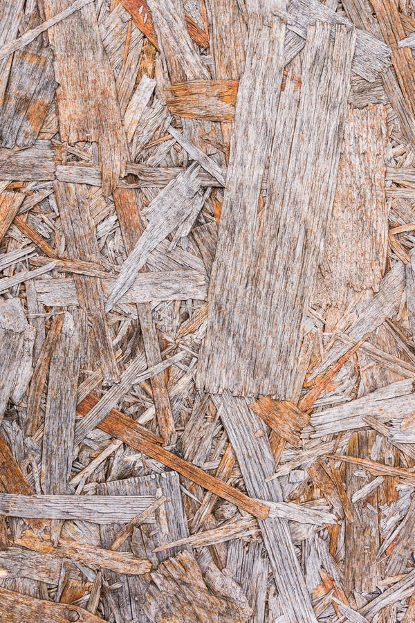 Recycled compressed wood chippings board background. Texture of wooden material royalty free stock photo