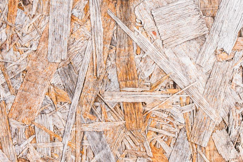 Recycled compressed wood chippings board background. Texture of wooden material royalty free stock image