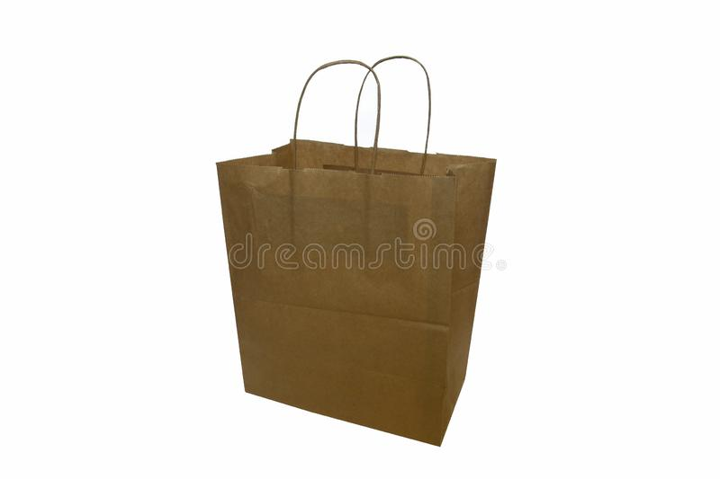 Recycled eco-friendly brown paper bag with twisted paper handles stock images