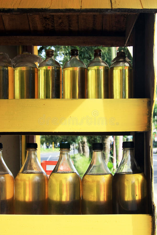 Recycled glass vodka bottles with fuel in Ubud, Bali, Indonesia. stock photos