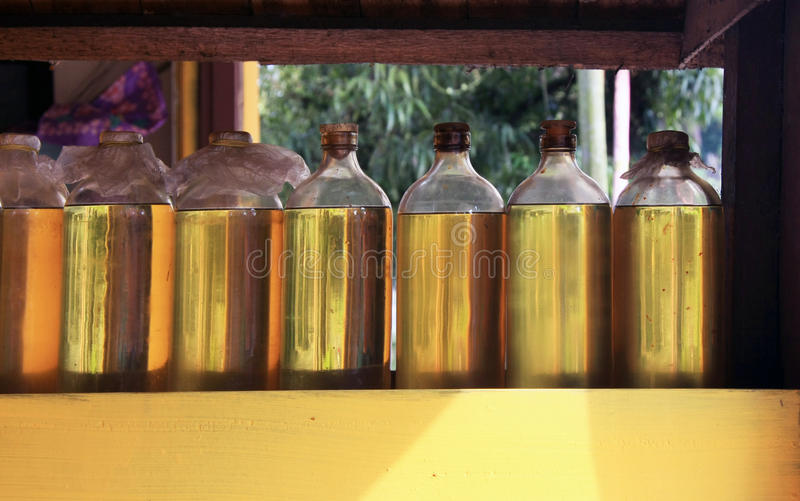 Recycled glass vodka bottles with Illegal gasoline stock photo