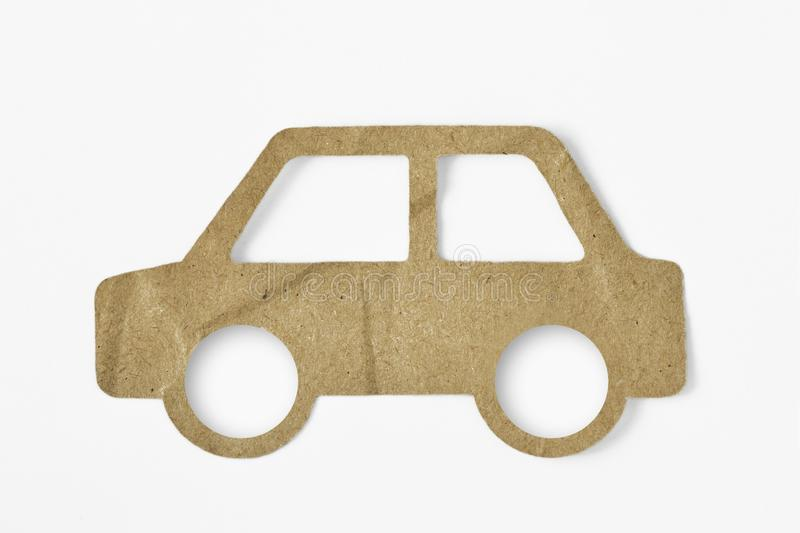 Recycled paper cut of car on white background - Eco-friendly car concept. Recycled paper cut of car on white background. Eco-friendly car concept royalty free stock photos