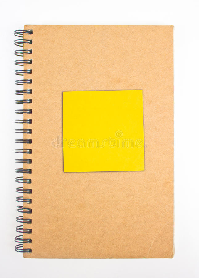 Recycled Paper Notebook Front Cover With Yellow Sticky Note. Recycled Paper Notebook Front Cover With Yellow Sticky Note Isolated On White Background stock photography
