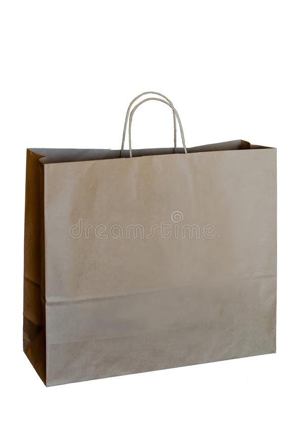 Recycled paper shopping bag isolated on white background. Paper recycling concept. Copy space royalty free stock photo