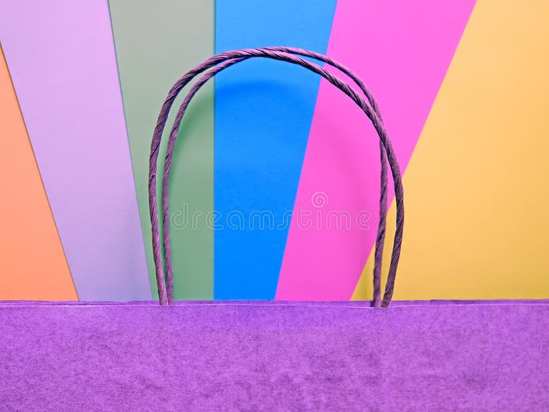 Recycled paper shopping bag on multicolored bright background in trendy colors. Recycled paper shopping bag on multicolored bright neon background in trendy royalty free stock photos