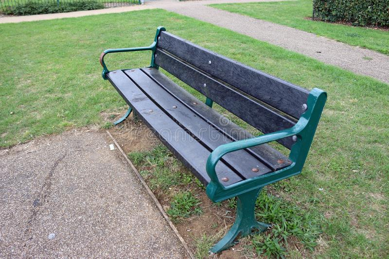 Recycled plastic seat in a park royalty free stock image