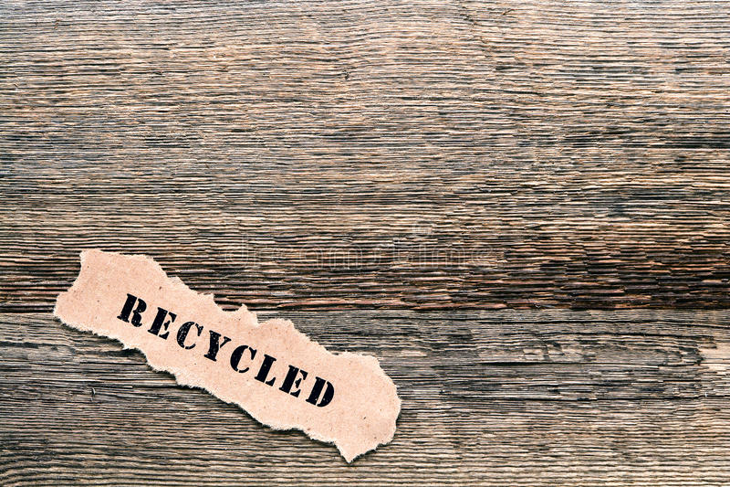 Recycled Title on Old Barnwood Lumber Background royalty free stock photo