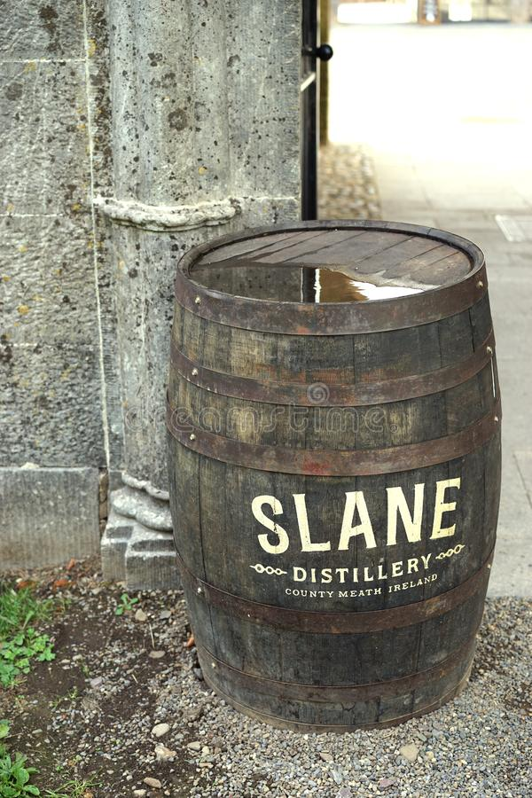 Recycled whiskey rain barrel. This water catchment barrel also serves to advertise for the local distillery in Slane, County Meath, Ireland. Rain barrels are stock photography