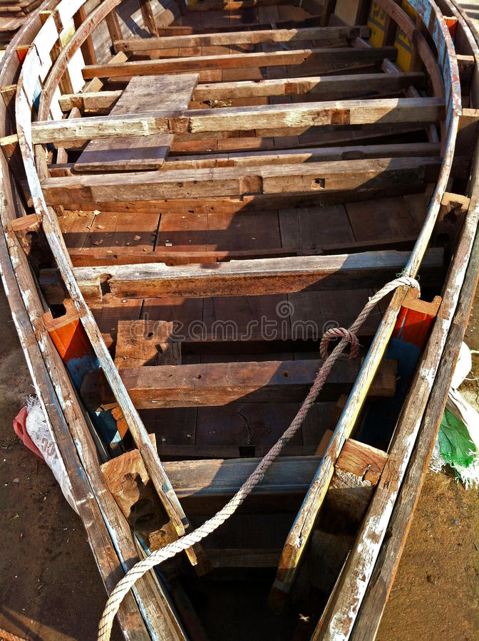 Recycled Wood Boat. A wood boat under construction made from scraps on the banks of the Ganges river in Varanasi India stock images