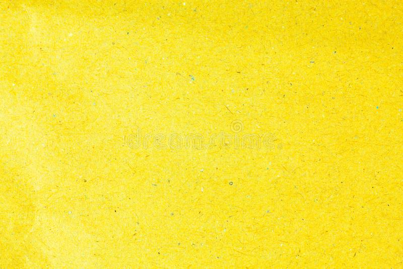 Recycleer gele document achtergrond royalty-vrije stock foto's