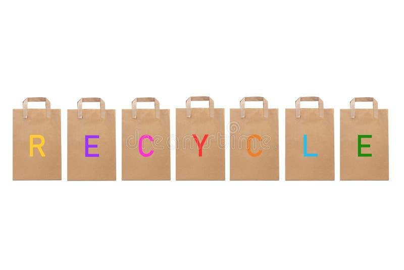 Recycleer woord schrijven in verschillende document zakken royalty-vrije stock afbeelding