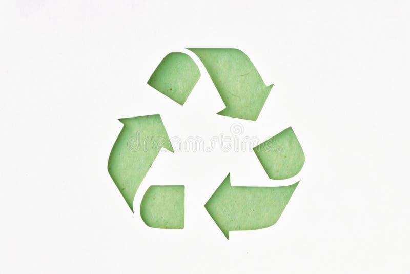 Recycligsymbool op gerecycleerd document stock illustratie