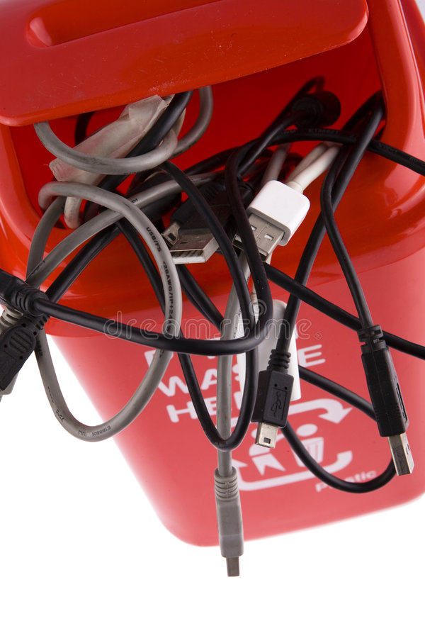Recycling. A red recycling bin full of recyclable things-electrical wire,tTerminal stock image
