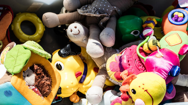 Recycling baby toys made of cheap plastic or fabric royalty free stock images