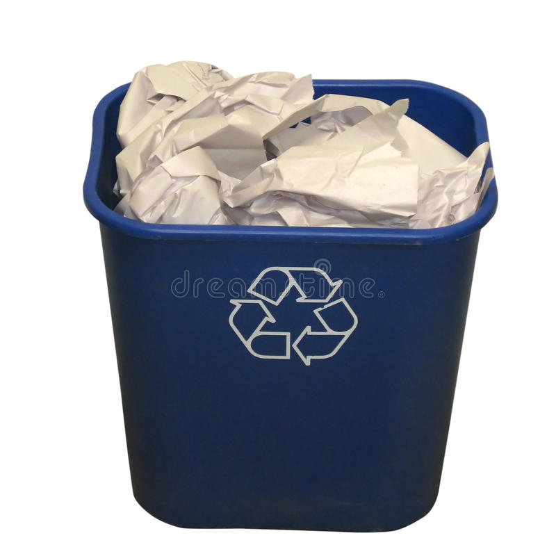Recycling bin. A blue recycling bin or basket with paper on a white background stock images