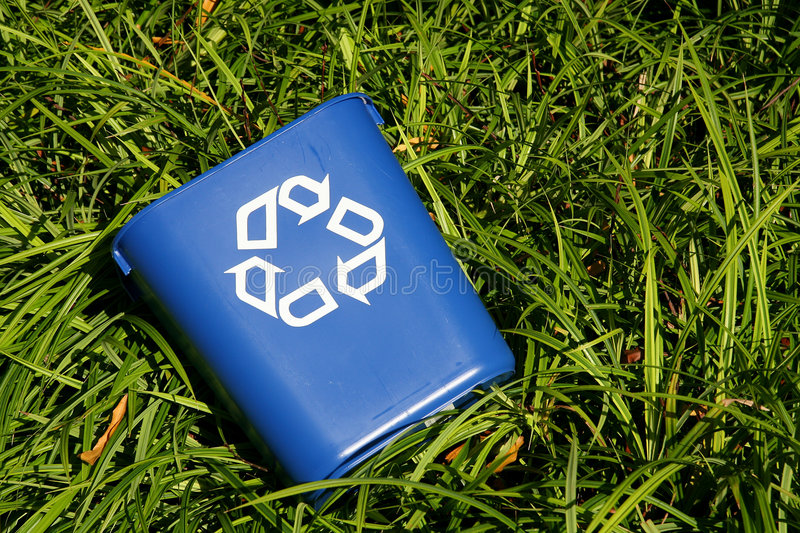 Recycling bin in bushes stock photo