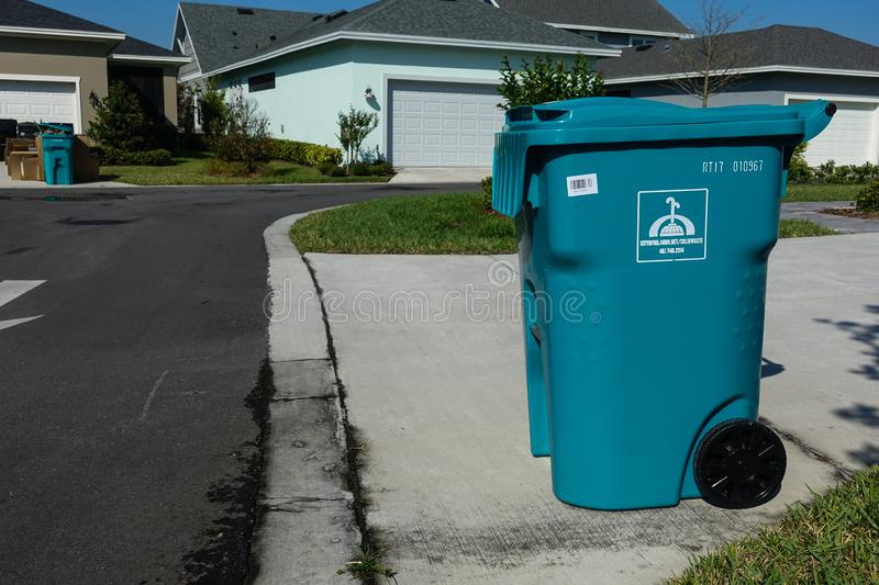 Recycling bin full in the driveway stock photography