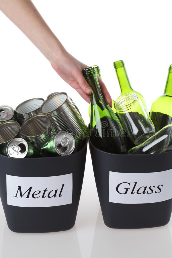 Recycling bins. With garbage: glass and metal royalty free stock photography