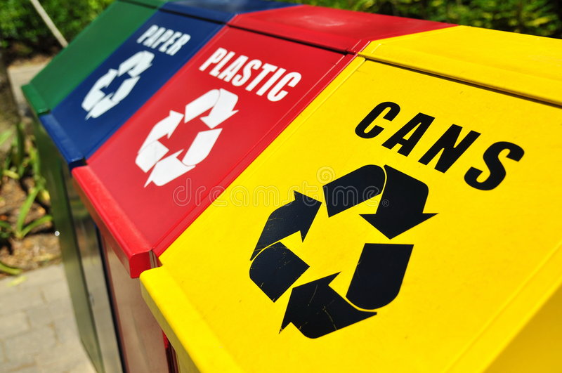 Recycling bins. New and clean recycling bins for different materials stock images