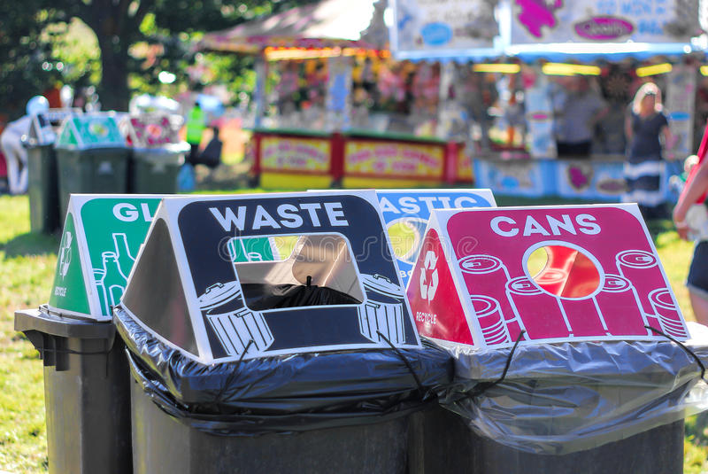 Recycling Bins At Public Festival Event. Several separate recycling bins for various materials at a music festival or other public event royalty free stock images