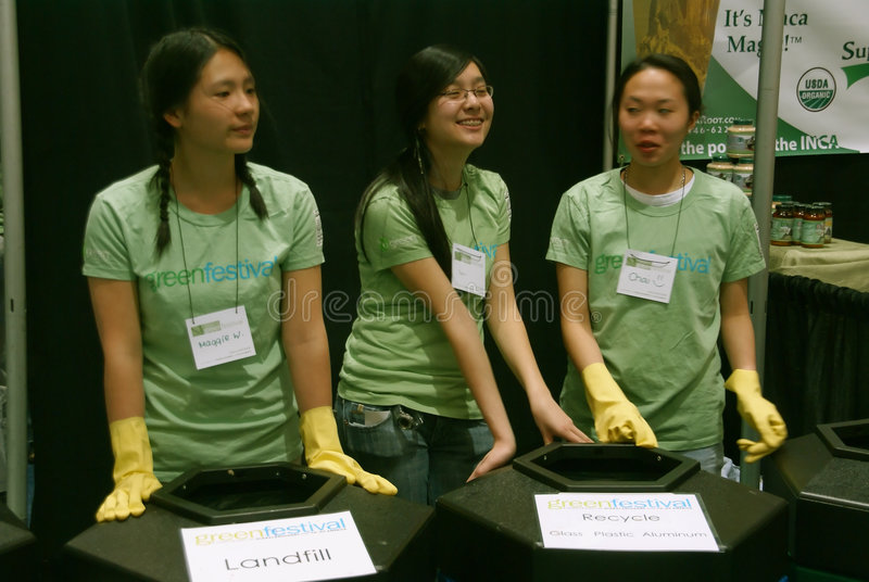 Recycling booth, 3 young Asian women royalty free stock image