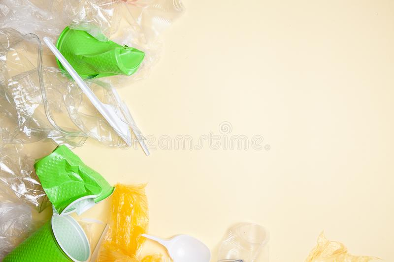Recycling concept. ecology, environmental pollution. Background of crushed and crumpled plastic. Top view copy space. Yellow royalty free stock image