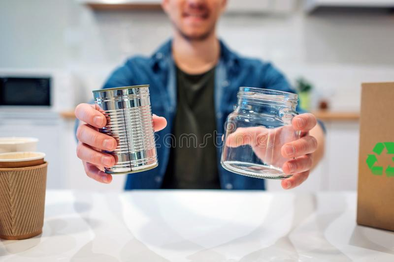 Recycling concept. Metal tin can and glass are prepared for recycling close-up. Selective focus stock photo