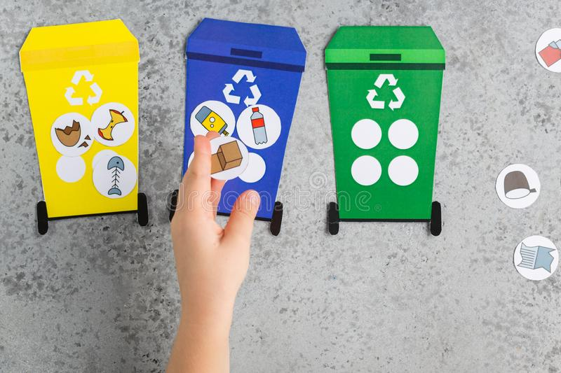 Recycling game design for children girl hands ecology education waste recycling concept stock photography