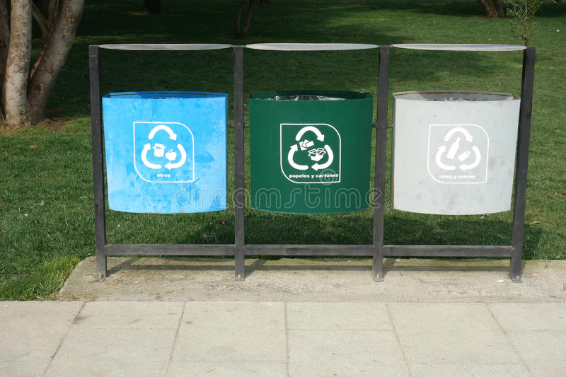 Recycling Garbage Bins. Three garbage bins in a park in Santiago, Chile, labeled in Spanish for recycling stock photos