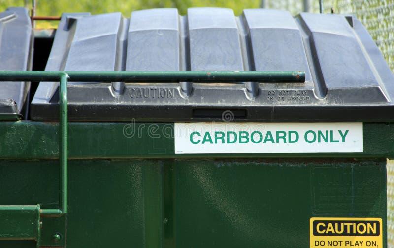 Cardboard Recycling Bin. A green cardboard recycling bin stock photo