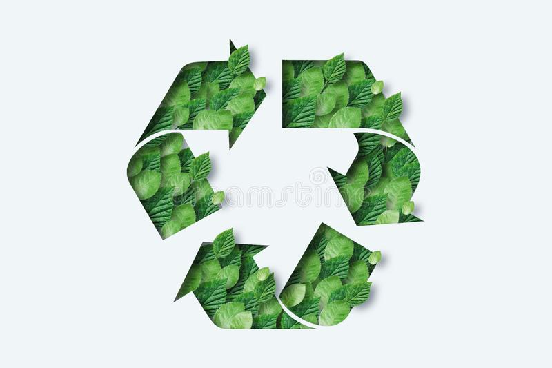 Recycling icon made from green leaves. Light background. The concept of recycling, non-waste production, eco-plastic, eco fuel.  stock illustration
