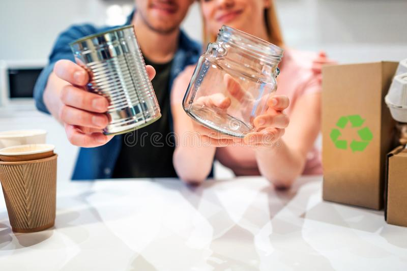 Recycling. Metal tin can and glass are prepared for recycling close-up. Selective focus royalty free stock photography