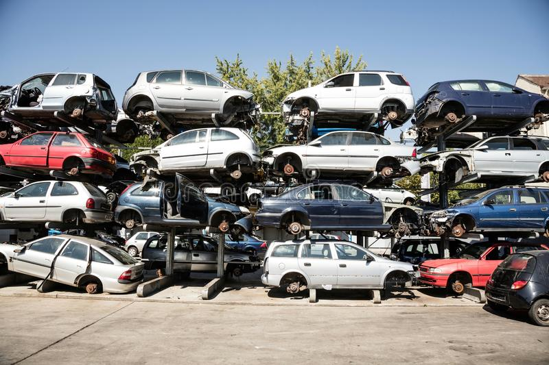 Recycling of old,used, wrecked cars. Dismantling for parts at scrap royalty free stock photography