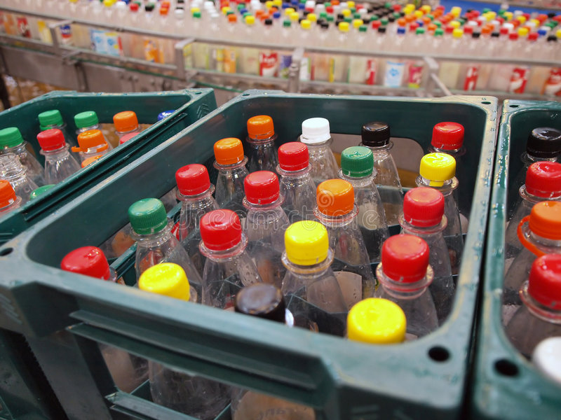 Recycling plastic bottles. Green industry - Recycling plastic bottles in a drinks factory stock images