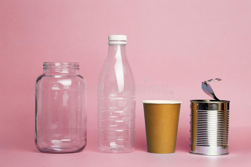 Recycling of plastic, metal, plastic and paper. Environmental pollution and waste recycling. Separate garbage collection.  royalty free stock image
