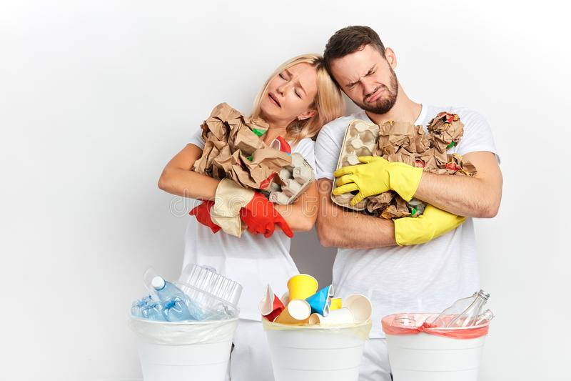 Unhappy crying man and woman hugging rubbish royalty free stock photos