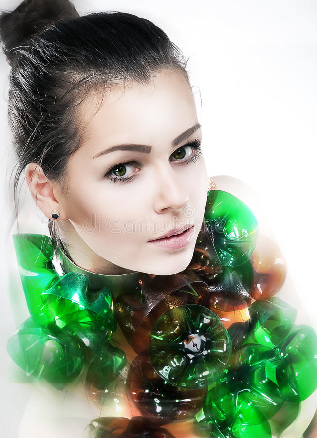 Recycling - pretty girl and bottoms of bottles stock images