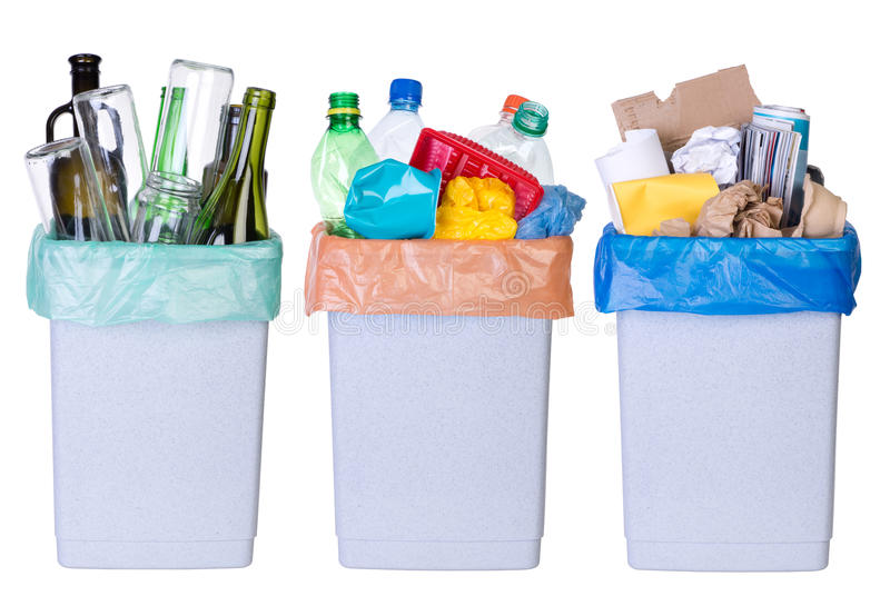 Recycling rubbish. Tree bins full of plastic, paper and glass isolated on white background stock image