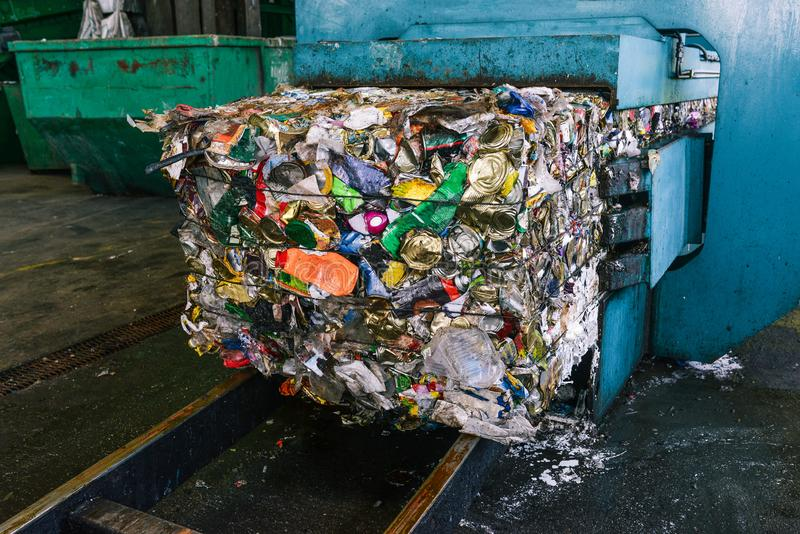 Recycling and sorting of household waste at the plant. Pressed trash for further processing. Recycling and storage of royalty free stock photo
