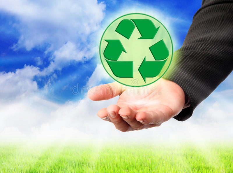 Recycling symbol on a man's hand. Caring hand hold recycle sign stock photo