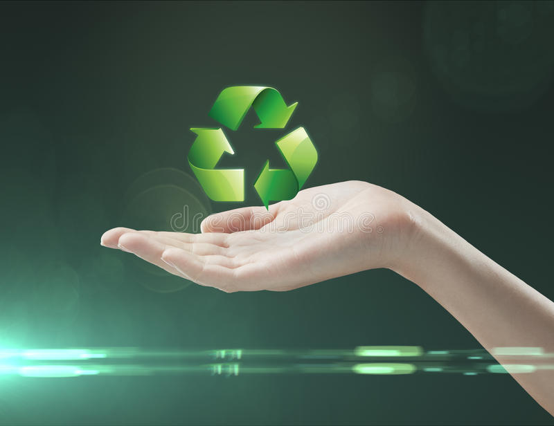 Recycling symbol on a woman's hand. Caring hand hold recycle sign stock photo