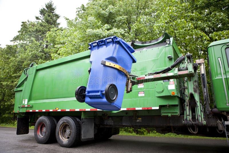 Recycling truck picking up bin - Horizontal.  royalty free stock photo