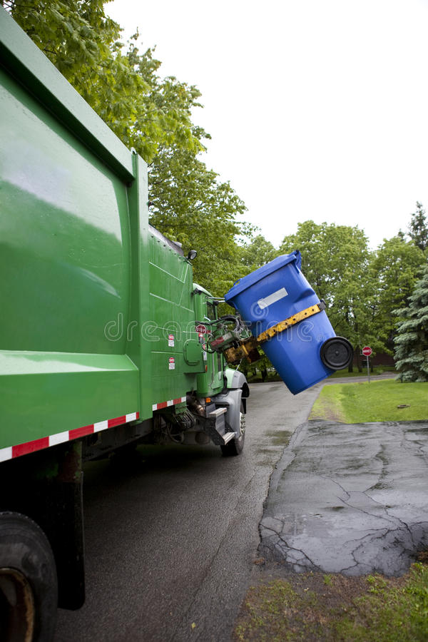 Recycling truck picking up bin - Vertical.  stock images