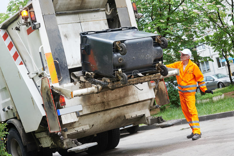 Recycling waste and garbage. Worker of municipal recycling garbage collector truck loading waste and trash bin royalty free stock photos